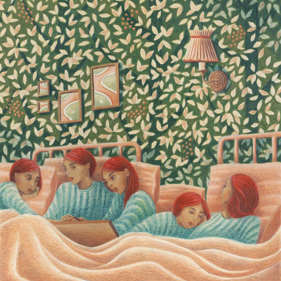 groupe de femmes roses avec pull bleu dans une chambre
