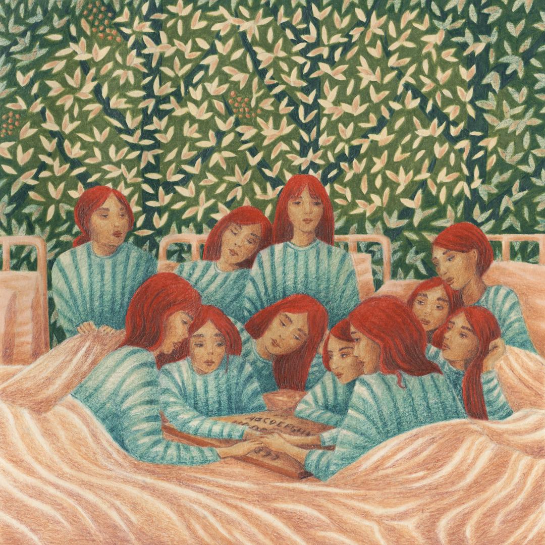 un groupe de femmes roses qui font un appel aux esprits